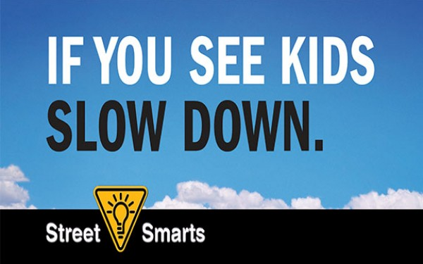 """If You See Kids Slow Down, blue sky with clouds """"Street Smarts"""""""