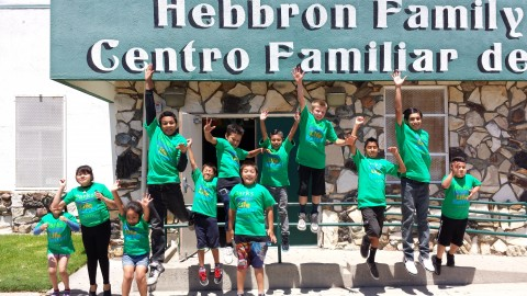 Teens in front of Hebbron Family Center